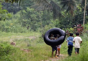 Elementary School Students Crossing A River On Inflated Tire Tubes, Rizal Province, Philippines Copyright Dennis M. Sabangan  EPA