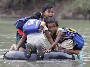Elementary School Students Crossing A River On Inflated Tire Tubes, Rizal Province, Philippines1 Copyright  Bullit Marquez AP