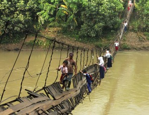 Pupils Crossing A Damaged Suspension Bridge, Lebak, Indonesia copyright Reuters).