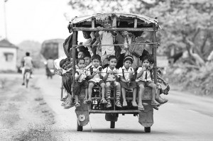 Riding a Tuktuk (Auto Rickshaw) To School In Beldanga, India copyright Dilwar Mandal