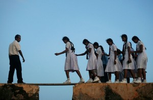 School Girls Walking Across A Plank On The Wall Of The 16th Century Galle Fort In Sri Lanka. copyright ReutersVivek Prakash