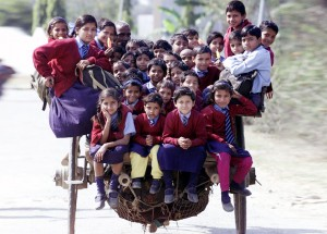 Schoolchildren Riding A Horse Cart Back From School In Delhi, India copyright Reuters