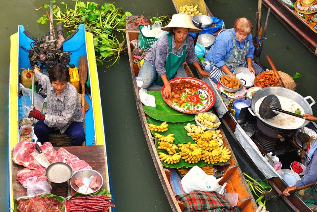 Damnoen Saduak, Thailand - March 07 2011 - Floating markets in Damnoen Saduak, Thailand. Until recently, the main form of trade, now mostly a tourist attraction