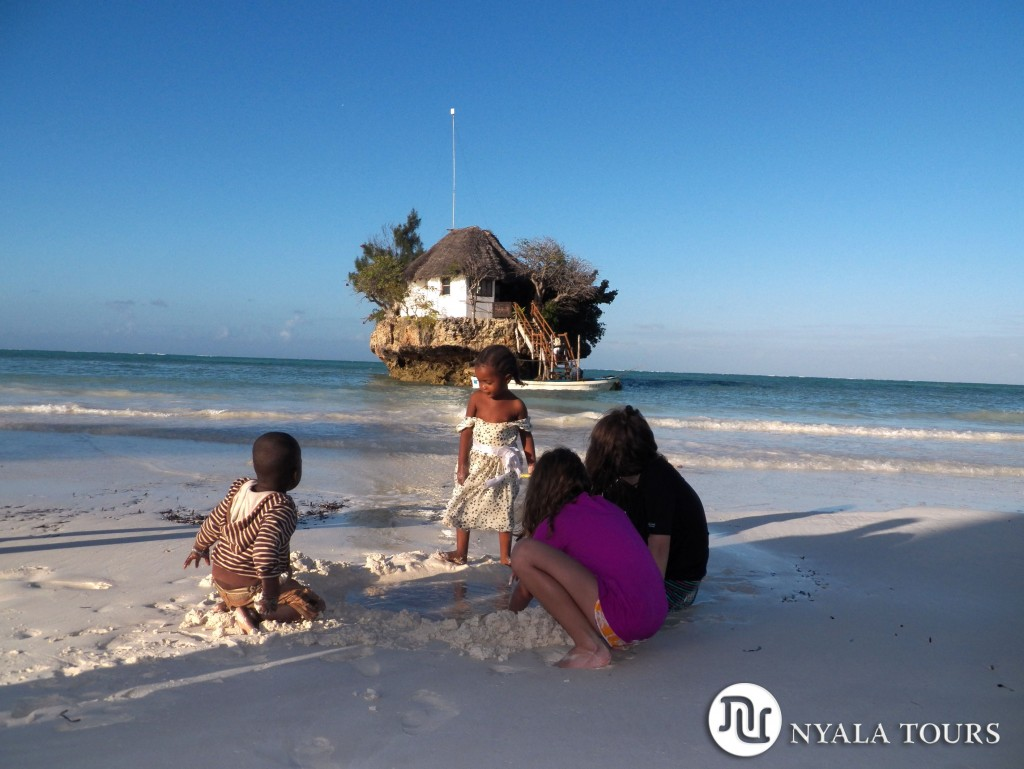 local-children-and-girls-playing-on-beach-the-rock